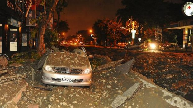 The force of the blasts overturned cars and left wide craters in the streets.