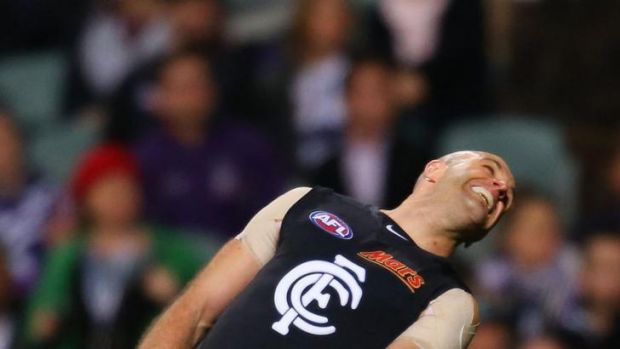 Chris Judd misses a shot on goal during Carlton's match against Fremantle.