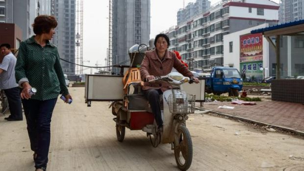 Chen Hua moves from her village shelter into her new urban home in Liaocheng, last year.