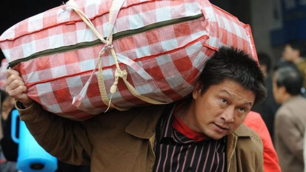 A migrant labourer returns to his home in Hefei. About 54 per cent of the population lives long-term in towns and ...