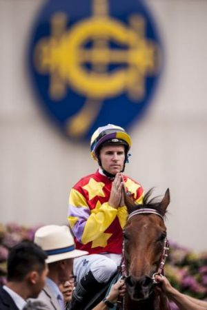 Grand designs: Tommy Berry celebrates after winning the QEII Cup  on Designs on Rome in Hong Kong in April.