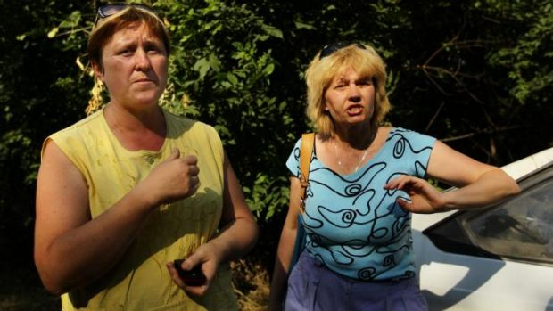 Teachers Olga Korostilenko (left) and Marina Tiheeva fleeing the shelling in Shakhtersk on Thursday.