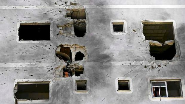 A Palestinian man inspects the damage to his home in Jabalia in the northern Gaza Strip.
