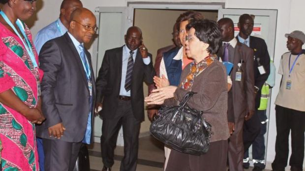 Director-General of the World Health Organisation Margaret Chan is greeted as she arrives in Conakry, Guinea.