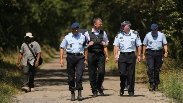 Australian Federal Police officer Brian McDonald (second from right) talks with his Dutch counterpart.