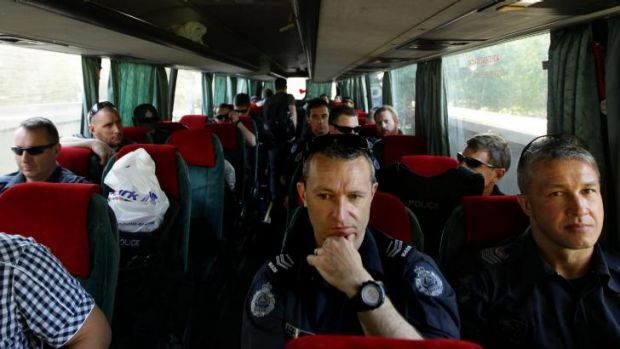 AFP officers on a bus head to Soledar village.