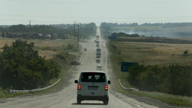 The convoy including the OSCE, Australian Federal Police and their Dutch counterparts making their way to the MH17 crash ...