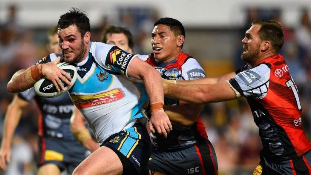 Roped in: Titans forward Luke Douglas is rounded up by the Cowboys.
