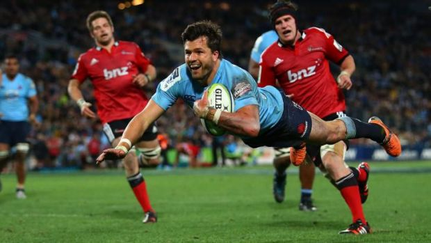 Double down: Adam Ashley-Cooper scores his second try for the Waratahs during Saturday's Super Rugby grand final.