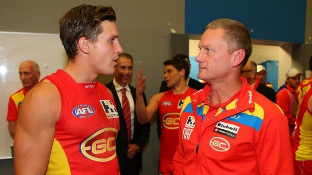 Mission accomplished: Star midfielder David Swallow and Suns coach Guy McKenna after the game.
