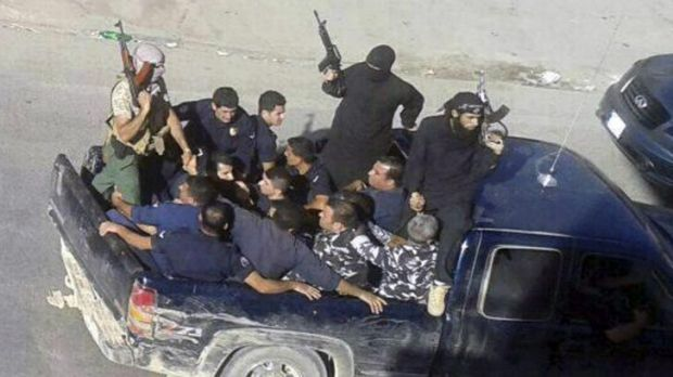Islamist gunmen drive away with two men in Lebanese military uniforms on Saturday in Arsal, a predominantly Sunni town ...