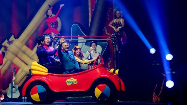 Beep beep, chugga, chugga: The Wiggles on stage in their familiar ride.