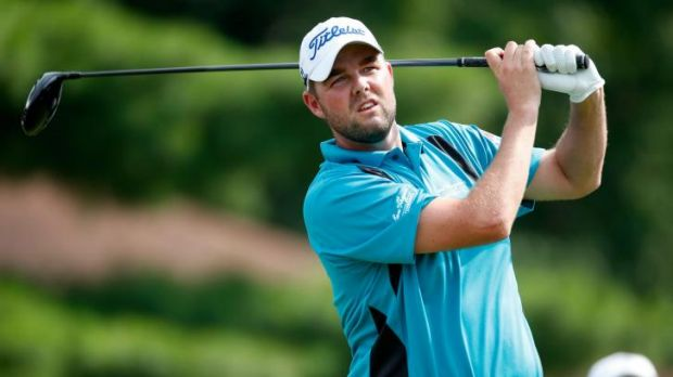 Marc Leishman hits off the eighth tee during the final round of the Bridgestone Invitational .