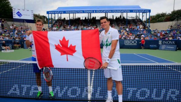 Vasek Pospisil (L) and Milos Raonic of Canada pose with the Canadian flag before the start of the mens final of the Citi ...