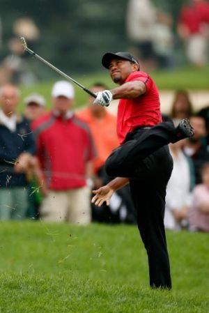 Tiger Woods hits out of the rough on the second hole during the final round of the Bridgestone Invitational.