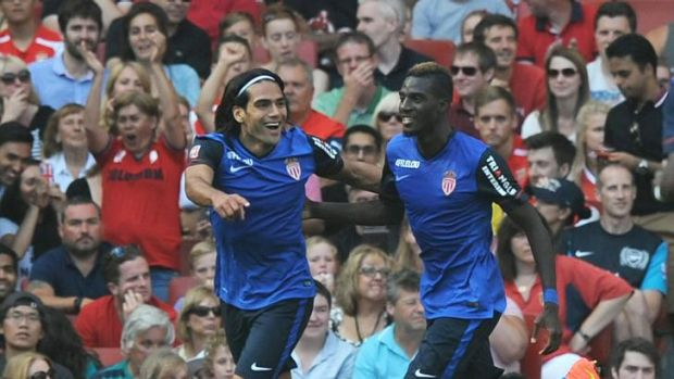 Radamel Falcao (L) celebrates scoring the opening goal.