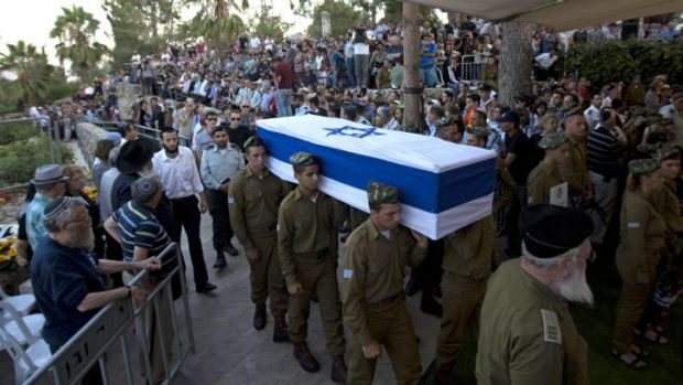 Israeli soldiers carry the coffin of Sergeant Barkay Shor, who was killed in fighting in Gaza.