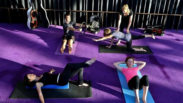 Health and wellbeing training: Instructor Jane Leathwood conducts a pilates class with SSO musicians David Campbell, ...