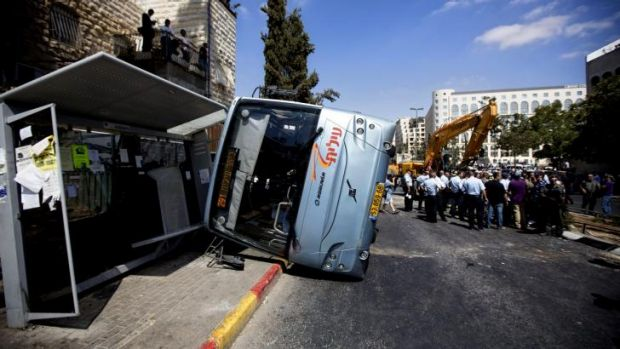 In East Jerusalem, a local Palestinian drove a construction vehicle over a pedestrian, killing him, then knocked over a ...