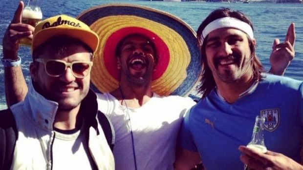 Adam Ashley-Cooper, Kurtley Beale and Jacques Potgieter whoop it up on the harbour on Monday.