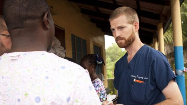 Dr Kent Brantly (right), one of the two Americans who contracted Ebola, works at an Ebola isolation ward at a mission ...