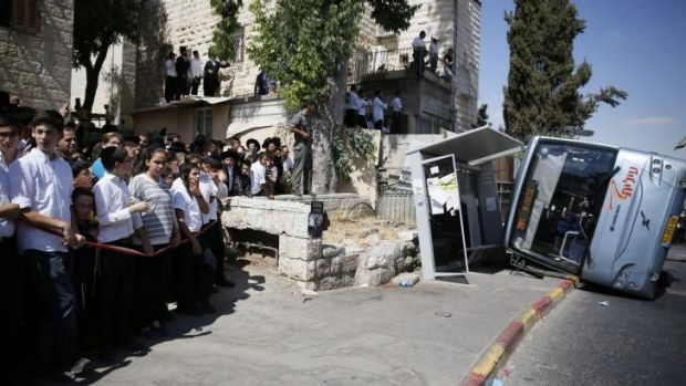 The overturned bus in Jerusalem on Monday.