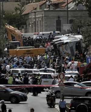Police and onlookers at the scene of the crime in Jerusalem.