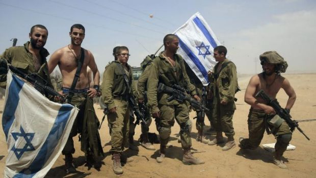 Back home: Israeli soldiers from the paratroop battalion return to Israel from Gaza on Monday.