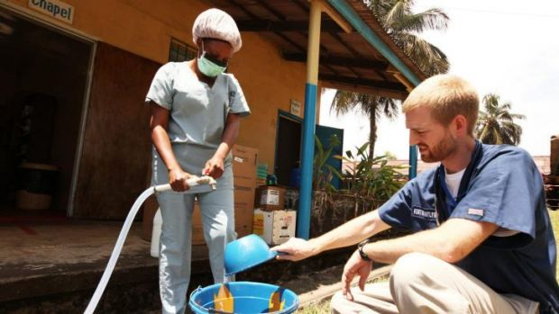 Dr. Kent Brantly, one of the two Americans who contracted Ebola, works at an Ebola isolation ward at a mission hospital ...