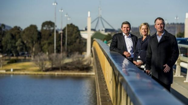 Authors and journalists Chris Uhlmann and Steve Lewis with Chief Minister Katy Gallagher on Commonwealth Bridge where a ...