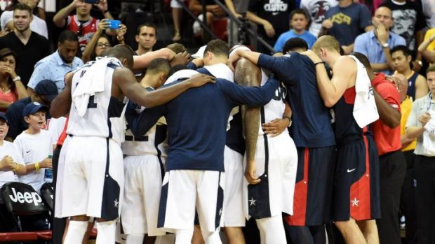 Togetherness: Team USA gather in a huddle after Paul George's injury.