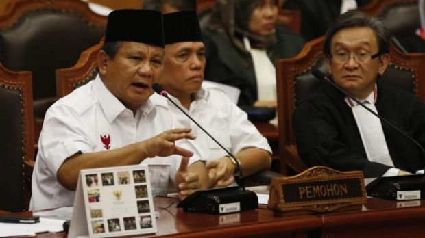 Prabowo Subianto, flanked by his running mate Hatta Rajasa, addresses Indonesia's Constitutional Court on Wednesday, ...