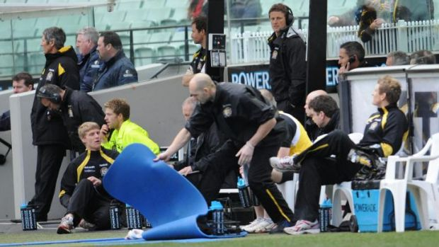 Life from the bench ... Damien Hardwick coaches from the interchange.