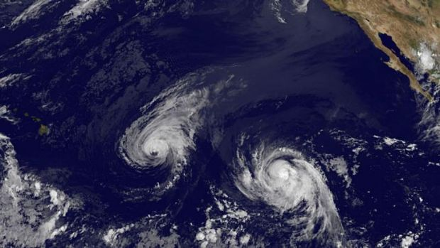 Double trouble ... Hurricane Iselle, centre, and Tropical Storm Julio, right, are heading toward Hawaii, left. Hurricane ...