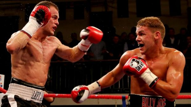 Australia's Jarrod Fletcher (left) during the 2012 Commonwealth Middleweight Championship bout against England's Billy ...