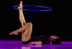 Feet first: Jessica Connell winds up during  her hula hoop routine.
