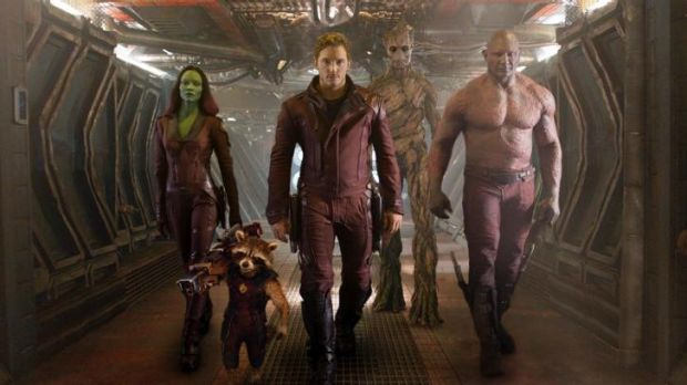 <i>Guardians Of The Galaxy</i> (from left) Zoe Saldana, the character Rocket Racoon, voiced by Bradley Cooper, Chris ...