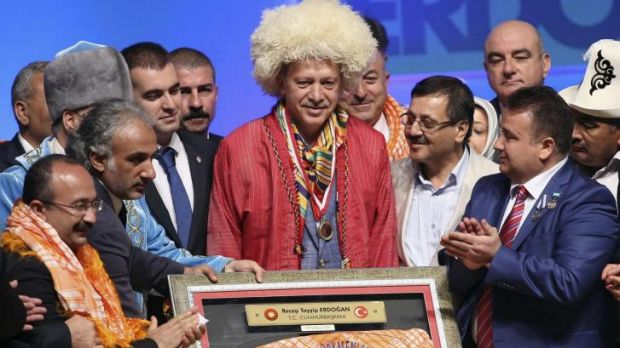 Big chief: Turkish Prime Minister and presidential candidate Recep Tayyip Erdogan is the centre of attention at a ...