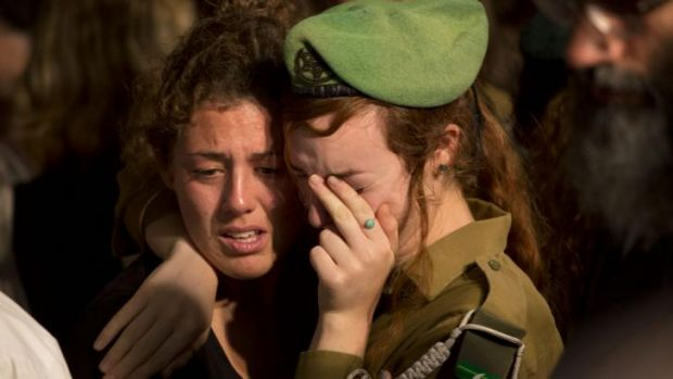 Mourners at the funeral for Israeli soldier Sergeant Barkay Shor' in Jerusalem.
