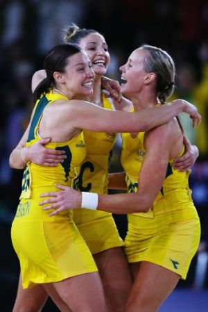 Madi Robinson, Kimberley Ravaillion and Renae Hallinan celebrate after Australia took out the Commonwealth Games gold medal.