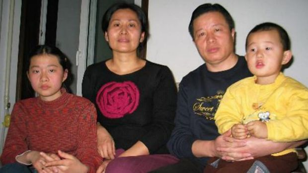 Gao Zhisheng, second right, his son Gao Tianyu, right, wife Geng He, second left, and daughter Geng Ge, left, at their ...