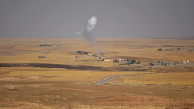 "Smoke rises during clashes between Kurdish ""Peshmerga"" troops and militants of the Islamic State on the outskirts of ..."