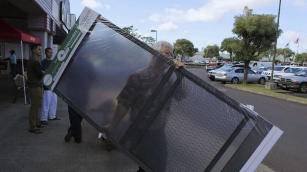 Walton Hong leaves a local hardware store with screen doors to prepare his house in Mililani, Hawaii ahead of the hurricanes.