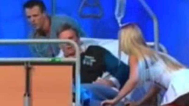 Newman was rolled off a hospital bed by a high-skirted nurse during The Footy Show.
