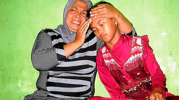 Emotional reunion: Jamaliah (left) with her daughter Raudhatul, thought killed in the 2004 tsunami.
