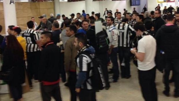 Juventus fans jostle for prime viewing position at Sydney airport.