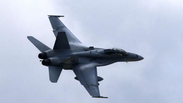 An F/A-18 Hornet, the kind of fighter that has escorted a US transport plane to bring supplies to the stranded Yazidis ...