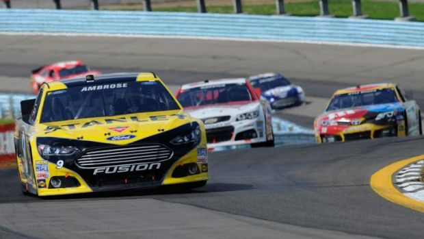 Road warrior: Marcos Ambrose leading the 2013 NASCAR Sprint Cup race at Watkins Glen, NY.