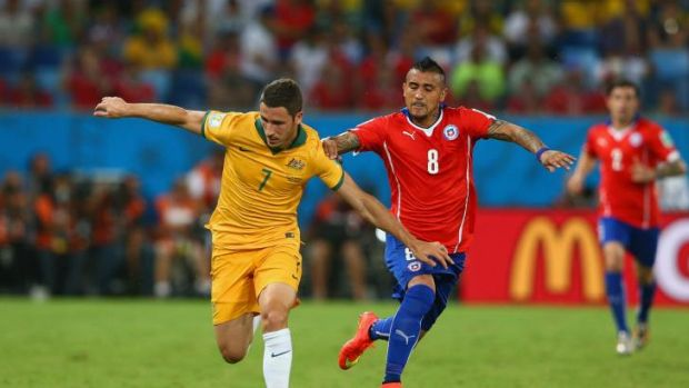Good form: Arturo Vidal challenges Mathew Leckie during Australia's match with Chile at the World Cup.