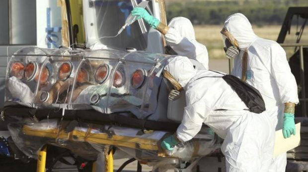 Aid workers and doctors in Spain transfer Miguel Pajares, a Spanish priest who was infected with the Ebola virus while ...